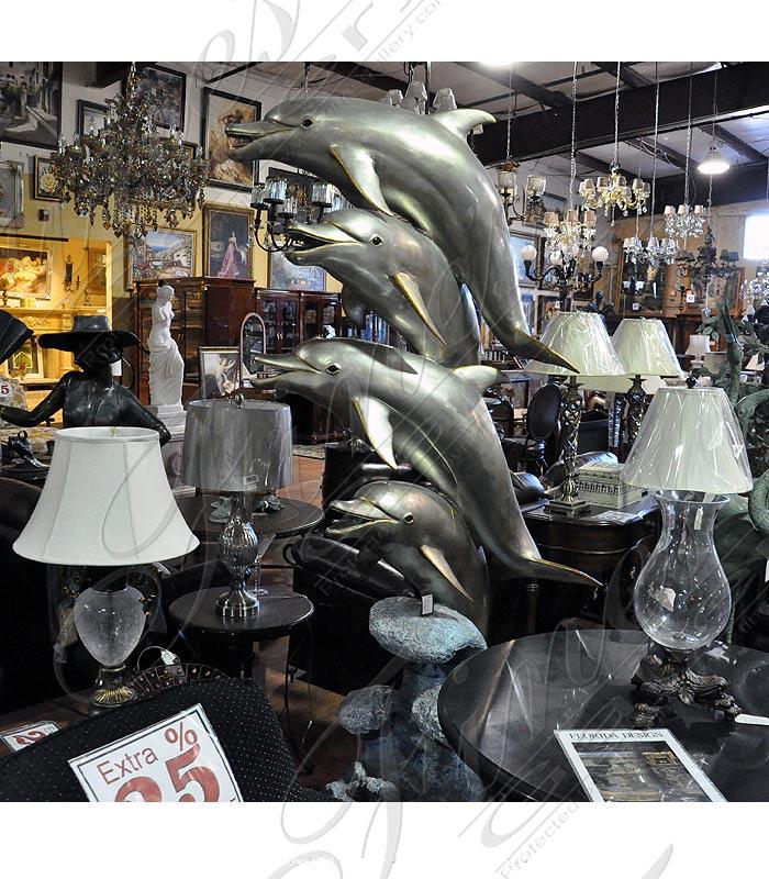 Four Dolphin Bronze Statue