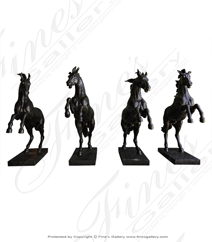 Four Rearing Horses In Bronze
