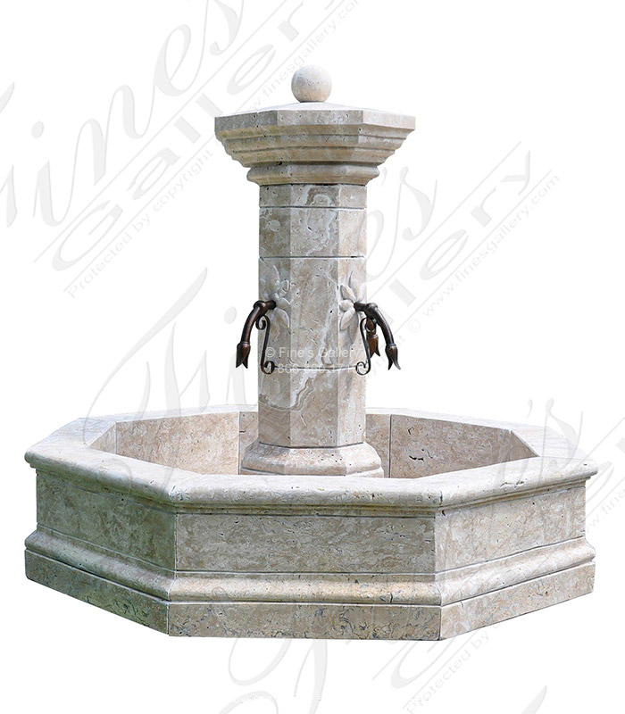 A stunning travertine limestone post fountain